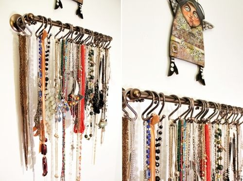 Necklace holder using a towel bar and shower curtain S hooks. Cute and functional (nice!)