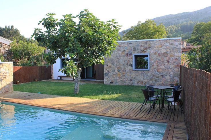 Outdoor swimming pool and garden of Portuguese villa Uma Casa Portuguesa - Ferraria de São João (Depois) by Uma Casa Portuguesa