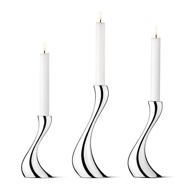 """The #Cobra range by #German #designer  #ConstantinWortmann  has become an #iconic part of #GeorgJensen's contemporary designs. """"The starting point for the Cobra #candlestick, the first design of this collection, was to find the archetype of a candlestick: broad foot, narrow waist and slightly wider top to hold the #candle. I distorted it in many ways to check its metamorphosis. One of this morphing was bending it like a wave. The result didn't look distorted, but very powerful and elegant…"""