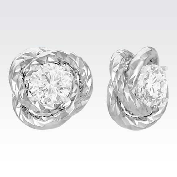 """14k White Gold Knot Earring Jackets (ShaneCo.com) (""""Create a whole new pair of earrings with these stylish earring jackets crafted in quality 14 karat Italian white gold with a textured design. Simply put the post of your solitaire earrings through the center of the earring jacket to create a fabulous combination. These jackets look best with and fit up to a 3/8 carat stone or 4.5mm pearl in each ear. The diamond solitaire earrings pictured are not included."""")"""