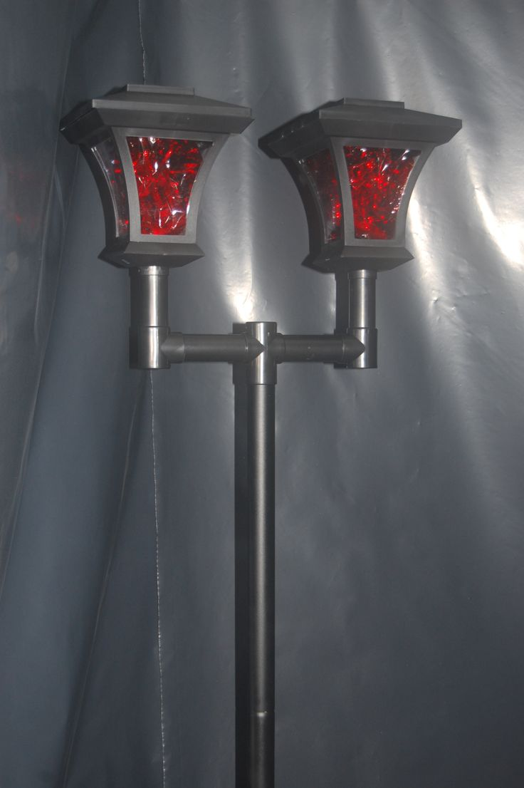 Red cellophane in lamp post to give a red glow