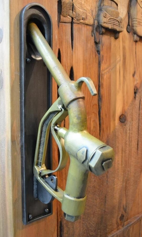 Repurpose gas pump handle as a door handle and the cars acrved into the wooden door arre awsome
