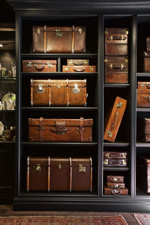 In the basement, I definitely want a series of storage rooms that lead off of a central corridor, similar to the downstairs of Downton Abbey. One as a wine cellar, the other for Christmas decorations etc, and then one like this for all the suitcases, picnic baskets etc.