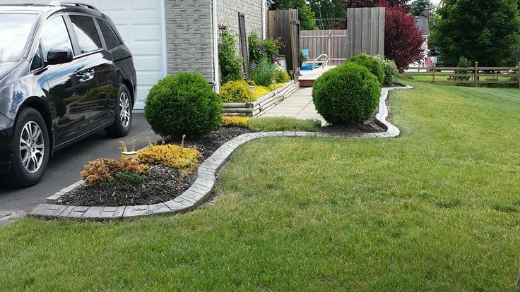 Driveways don't have to be edged with straight beds, not with Curb-Ease quality and style at your design whim.