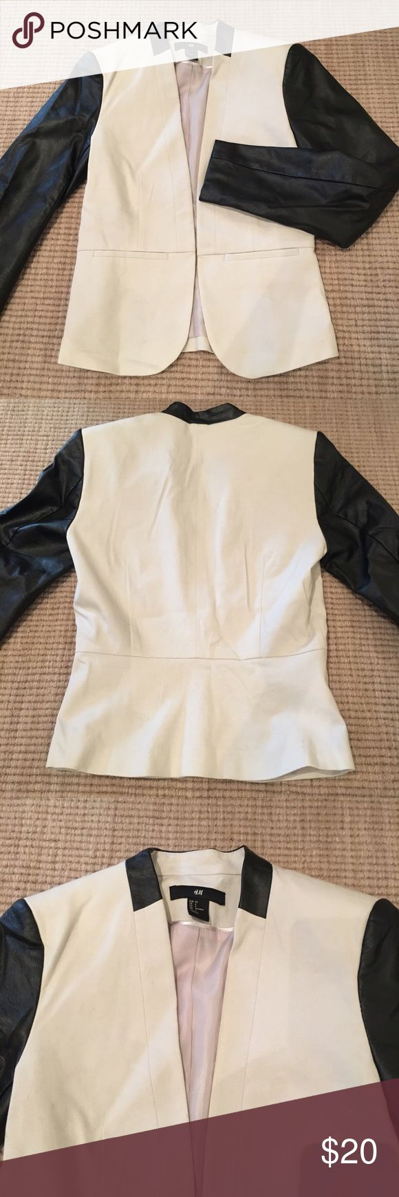 H&M linen front with faux leather sleeve jacket Ivory linen bodice with peplum bottom and two stitched closed slit pockets. Faux leather sleeves. Dress it up and go to work, Pair it with a black dress or jeans. It's a winner! H&M Jackets & Coats Blazers