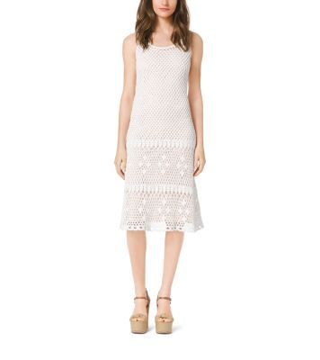 A key style for the season, our crocheted dress embodies bohemian glamour. Cut for a tailored fit, this polished piece is rendered in soft cotton with an open-stitch design. Wear it solo or with a cardigan and leather belt and embrace spring's soft new mood.