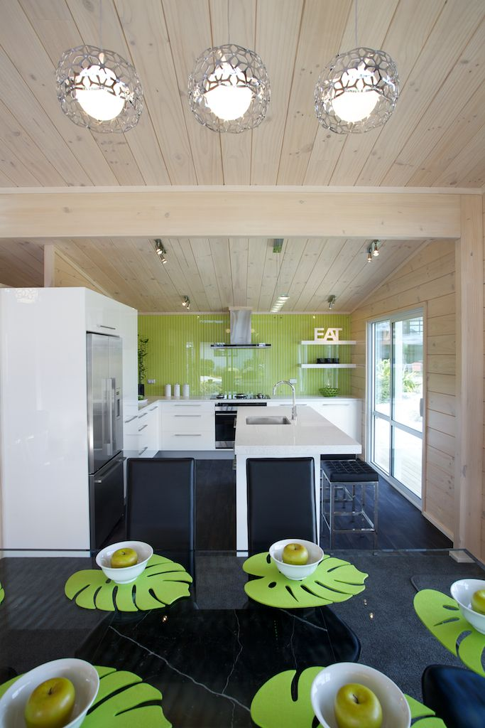 Te Rakau Lockwood show home with green feature splash back in kitchen and solid laminated beam feature