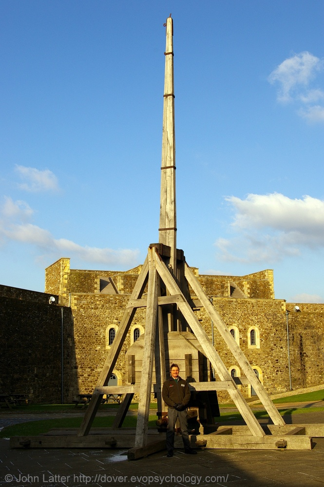 Medieval Trebuchet in Dover Castle Keep Yard, Kent, England, UK. Keith Ashley-Thomas (English Heritage tour guide) and siege engine in front of King's Gate (Inner Curtain Wall) in 2009. First Great Siege of Dover Castle was in 1216 when Prince Louis of France (later Louis VIII) sided in First Barons' War against King John. Catapult was used in 1217 when siege resumed. Listed Building and Scheduled Ancient Monument. Norman History, Travel and Tourism. See: http://www.panoramio.com/photo/30345...