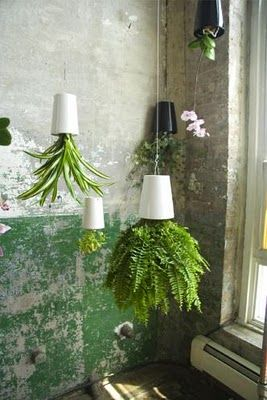 upside-down hanging herb planters... perfect for the kitchen or balcony
