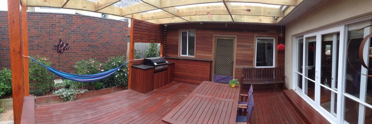 BBQ area with spotted gum classed wall