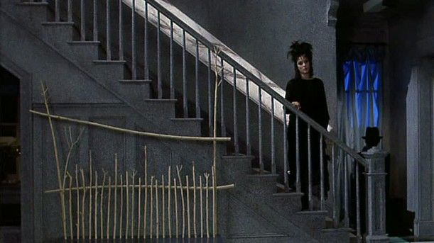 "Beetlejuice House set photos, after the Deetz family moves in and renovates..The house is almost comically ""artistic"" and edgy with gray walls and odd sculptures..Tim Burton set design"