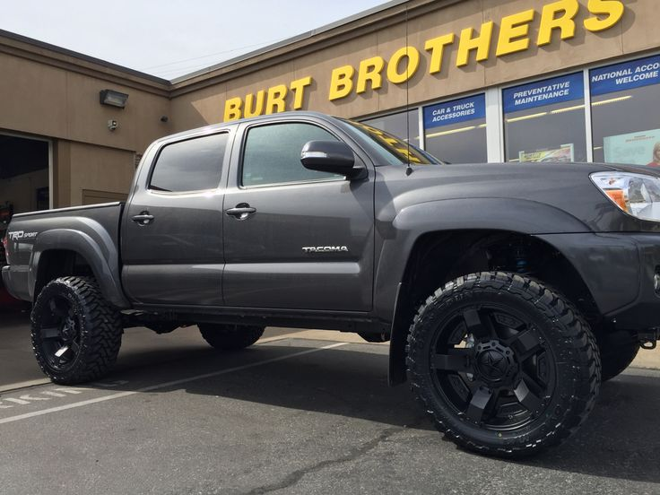 """Tacoma with 20"""" XD rockstar 2 and 275/55R20 Toyo MT's 