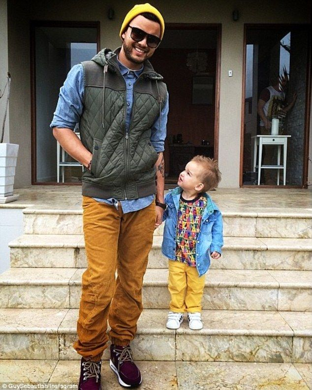 Like father like son: Guy Sebastion,32, posted a photo of himself with his two-year-old son Hudson after the little man had his locks trimmed