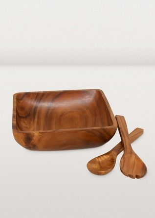 Who says bowls all have to be round? This gorgeously buffed bowl is crafted from a single piece of acacia wood. Just add a big, leafy salad and enjoy. Handy salad servers included. Buy matching salad bowls to complete the set.