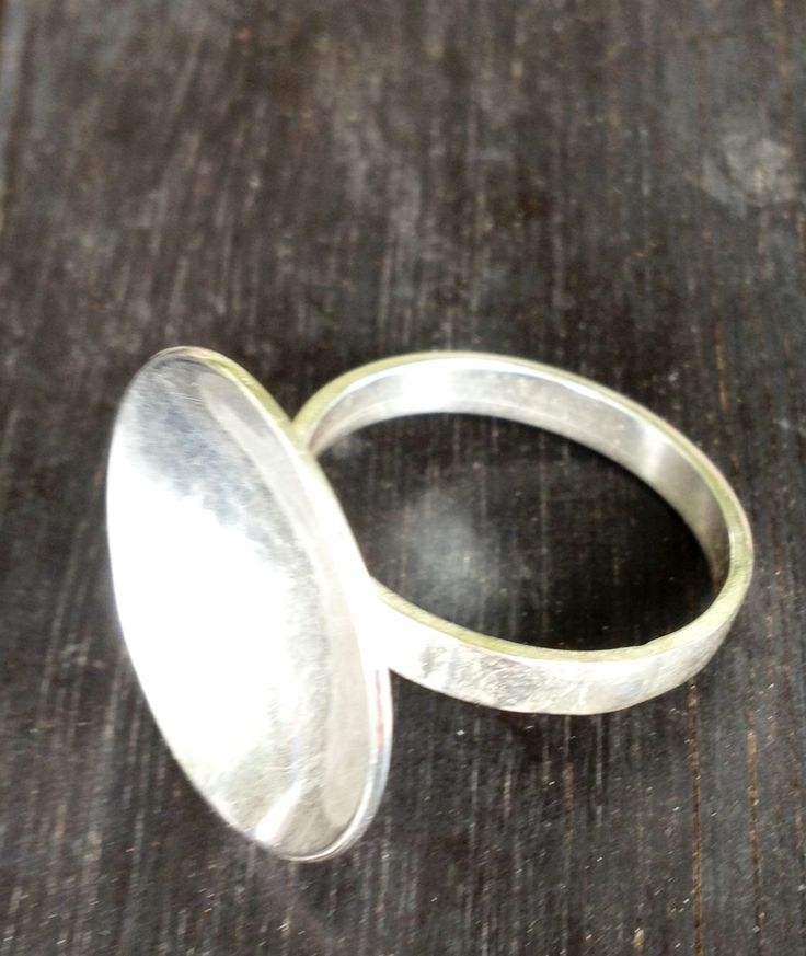 Sterling silver concave ring.
