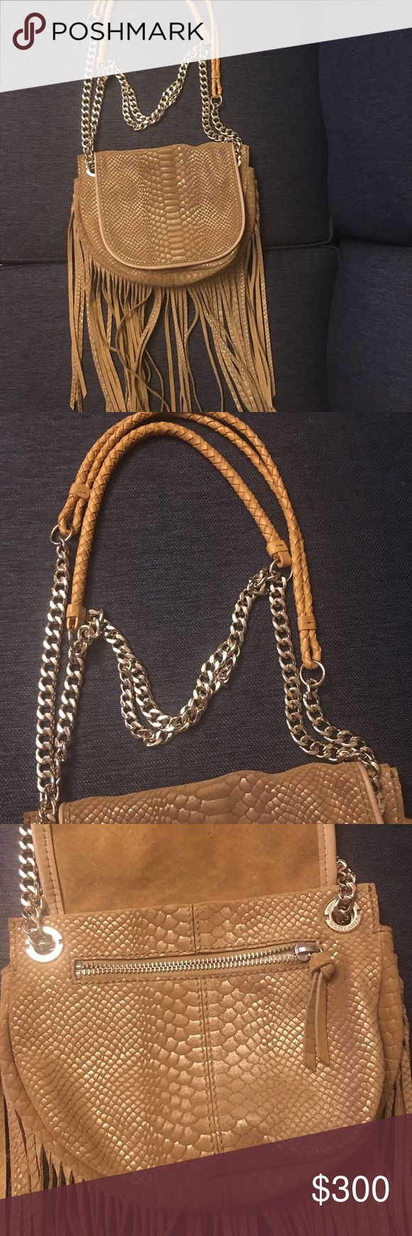 """Ramy Brook Camile fringed messenger leather bag This bag is a real statement piece. A Ramy Brook soft leather bag in a light cognac color. It has beautiful fringe (which measure about 11"""" long). It has a gold and leather strap which can be converted from shoulder to crossbody. The hardware is very solid and substantial. This little darling packs a punch. Definitely a conversation starter. It has a pocket in the front under the flap, another one on the back and a zippered one on the inside…"""