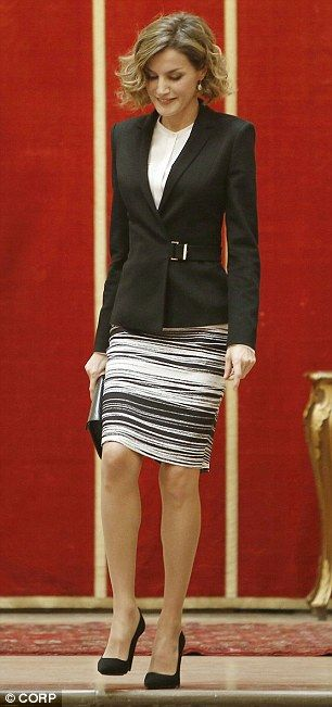 The 43-year-old looked as chic as ever in a recycled black and white striped split skirt...