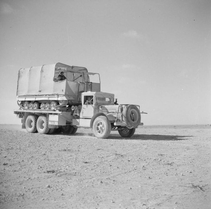 BRITISH ARMY NORTH AFRICA 1942 (E 12293)   A transporter carrying a Valentine tank camouflaged as a lorry, May 1942.