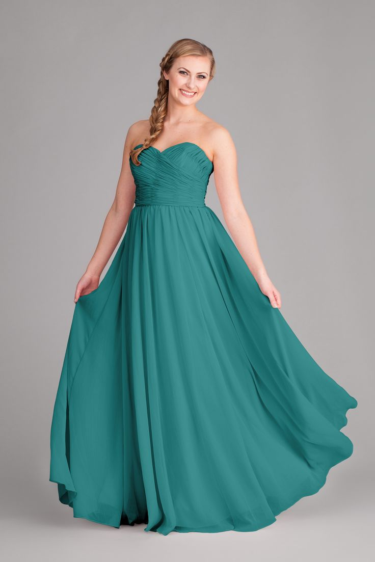 A long, strapless chiffon bridesmaid dress in teal.