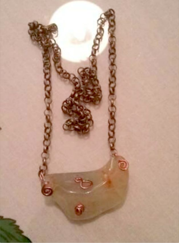 A very beautiful chalcedony necklace with copper metals and brass chain to help you search deeply in your soul and find the correct answers to your questions. It can show you the way for your spiritual growth and at the same time it can give you the strength and the courage to follow it.