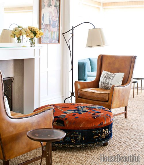 Leather chairs, upholstered ottoman and lamp next to the fireplace....just a little further away!