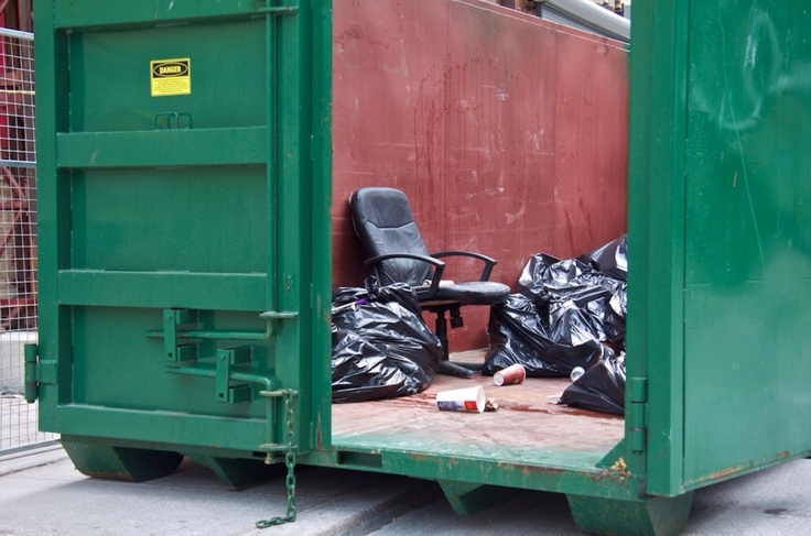 Chairs released into the urban landscape often resort to living out of dumpsters. Please recycle.
