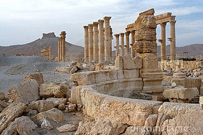 Colonnades and castle, Palmyra  Roman columns and collonades at the southern end of the great city of Palmyra in the Syrian desert. In the background is the arab castle of Qalat Ibn Maan