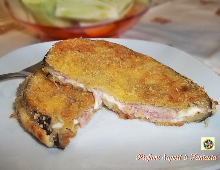 Cotolette di melanzane ripiene, con prosciutto e formaggio: squisite facili e veloci da preparare un'ottimo piatto unico da servire tiepide, la cottura in forno