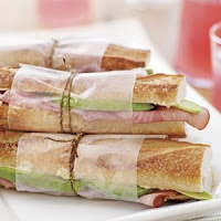 Ham sandwiches on baguette - wrapped in wax paper with twine