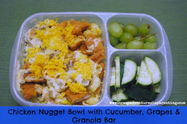 Chicken nugget bowls with mashed potatoes, corn, and shredded cheese for school lunch