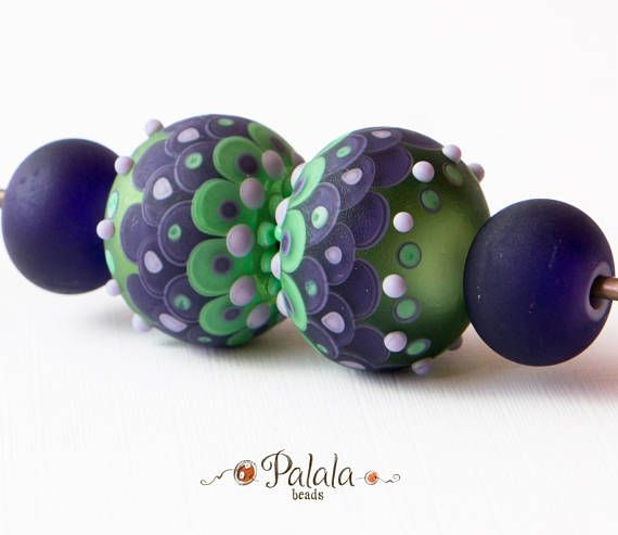 set of violet and green matted lampwork beads