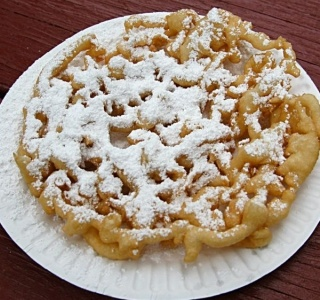 Funnel Cakes...My hubby was wanting to find a fair somewhere tonight to buy one of these so I tried this recipe.  They were perfect!