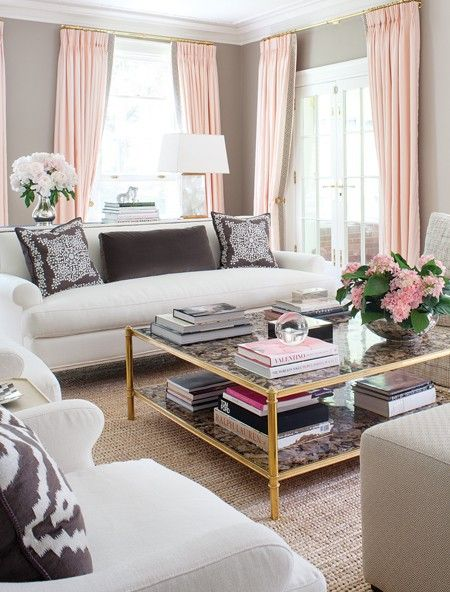 beautiful, soft color palette.  grey walls, blush draperies, vintage brass coffee table, and accents of chocolate.  anne hepfer.