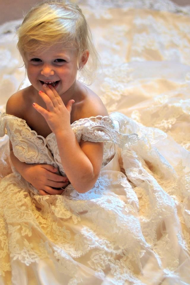 Photograph your daughter in your wedding dress to give to her on her wedding day.