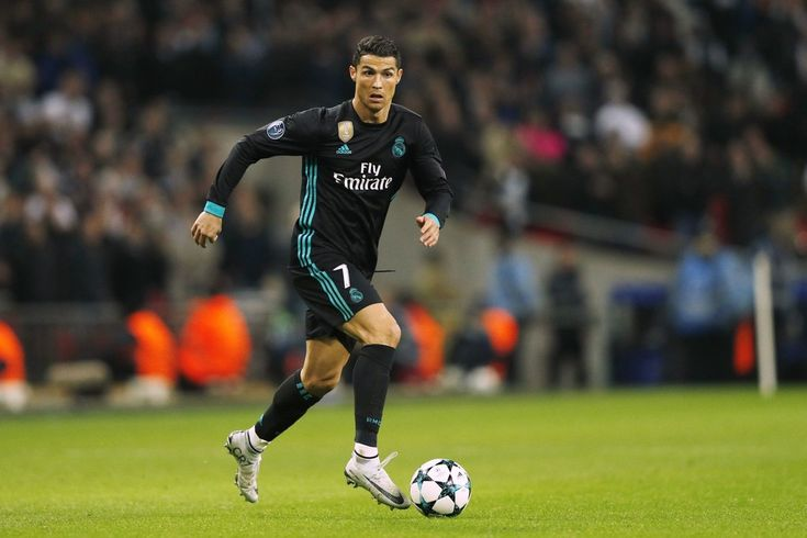 Cristiano Ronaldo Photos - Real Madrid's Portuguese striker Cristiano Ronaldo runs with the ball during the UEFA Champions League Group H football match between Tottenham Hotspur and Real Madrid at Wembley Stadium in London, on November 1, 2017. / AFP PHOTO / Adrian DENNIS - Tottenham Hotspur v Real Madrid - UEFA Champions League