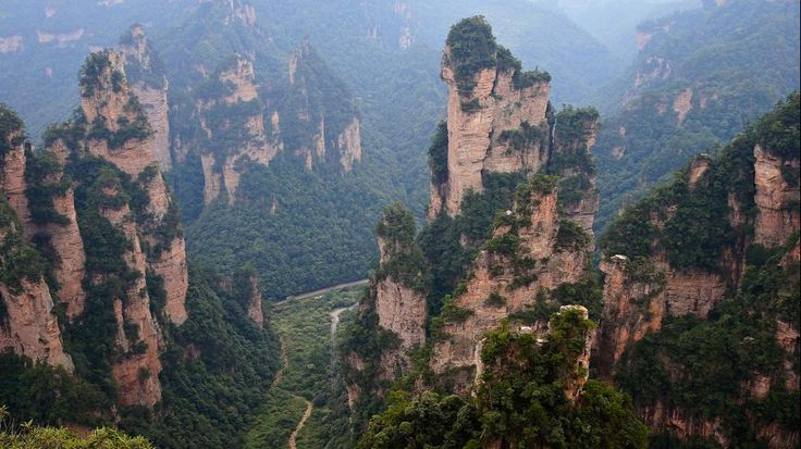 50 Places to See in Summer (PHOTOS) - Zhangjiajie National Forest Park, is a popular tourist destination in the Hunan province, home to striking sandstone and quartz cliffs. It is famously known for renaming a peak after the mountain formations inspired the fictional world of 'Pandora' in James Cameron's film, 'Avatar'. (Getty Images/Lintao Zhang)