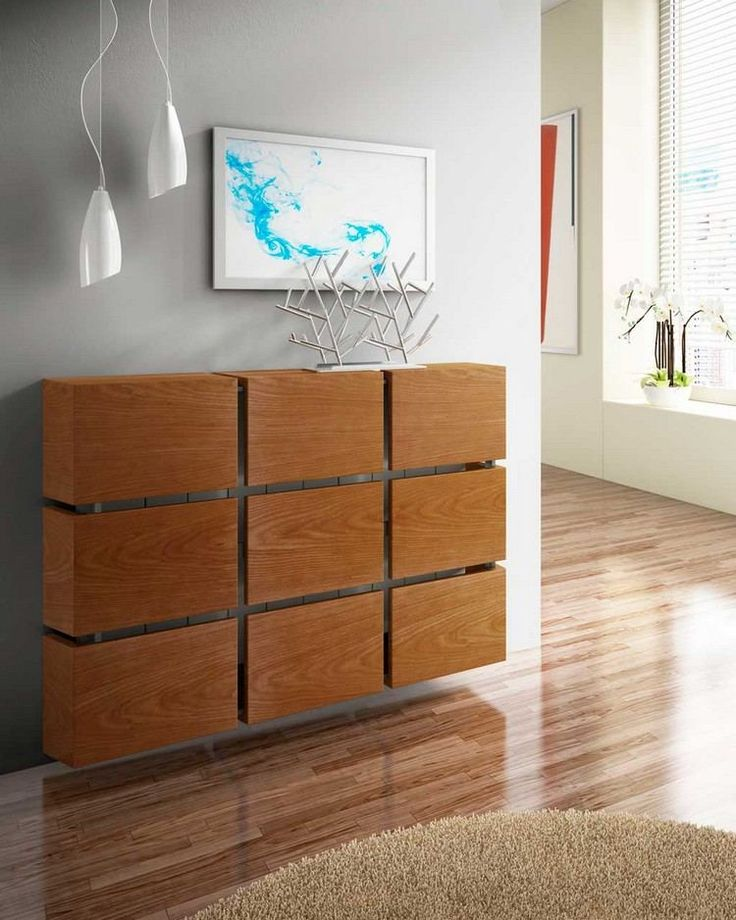 Wooden radiator hood of ultra modern design in rectangular wooden fragments