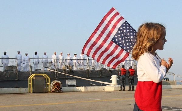 Seven-year-old Madison bids her dad Petty Officer 2nd Class Benjamin Doyle goodbye on his first deployment aboard the USS Jason Dunham Wednesday from Norfolk Naval Station. (Adrin Snider / June 20, 2012)