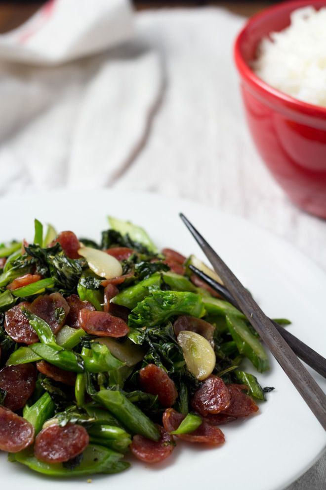CHINESE BROCCOLI WITH CHINESE SAUSAGE==Serves: 2 Ingredients== 1-2 Chinese sausage, 1 t olive oil 1 t sesame oil 3 garlic cloves, sliced ½ lb Chinese broccoli (Kai Lan) 3 T chicken broth ¼ t sugar ½ T soy sauce salt and pepper, to taste ====