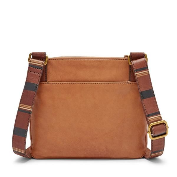 """Fossil is an American watch and lifestyle company, creatively rooted in authentic vintage and classic design.Hands free. Pockets aplenty. Fossil's newest Corey crossbody is all zipped up and ready to go (go, go) in smooth leather and an adjustable strap.    Exterior materials: Leather Silhouette: Crossbody Interior details:2 Slide Pockets, 1 Zipper Pocket Measurements:10""""L x 2.25""""W x 8.75""""H Handles/straps:Adjustable Crossbody Strap Designed for: Women   Fossil is ..."""
