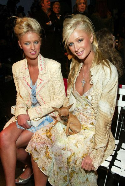 Paris and Nicky Hilton showing their sisterly bond at a fashion show.
