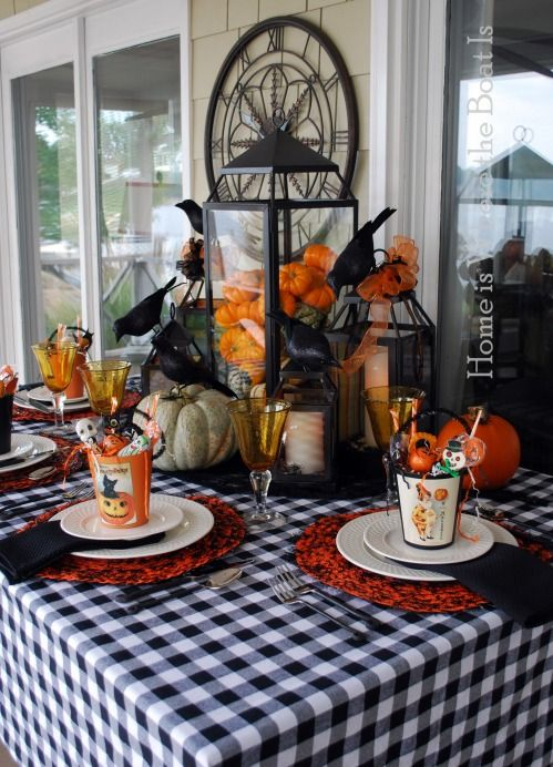 A jolly Halloween tablescape using Pier 1 Black & Orange Tinsel Placemats