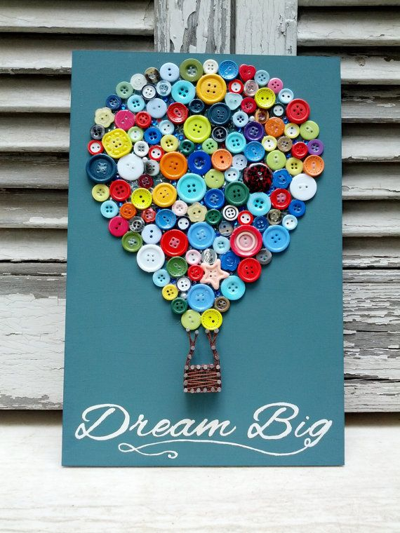 This wooden decoration, A hot air balloon made with buttons and partially string…