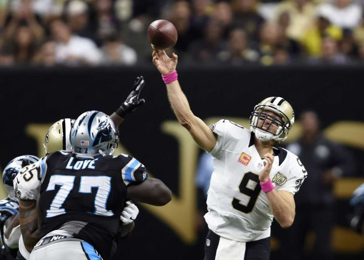 Panthers vs. Saints:      October 16, 2016  -  41-38, Saints  -    New Orleans Saints quarterback Drew Brees (9) throws a touchdown pass to Coby Fleener, not pictured, under pressure from Carolina Panthers defensive tackle Kyle Love (77), in the second half of an NFL football game in New Orleans, Sunday, Oct. 16, 2016.