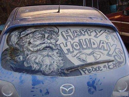 drawing on a dirty car window