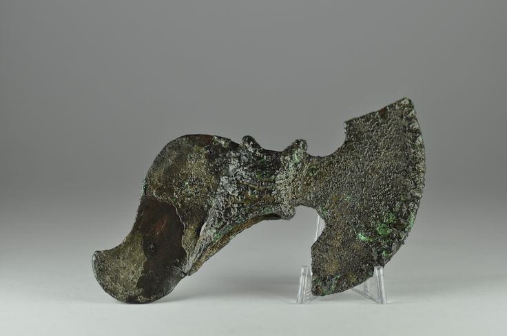 Luristan bronze axe head, 2nd-1st millenium B.C. Luristan Bactrian bronze shaft hole axe head with rounded lunate blade, an eye in the middle, 11.2 cm long. Private collection
