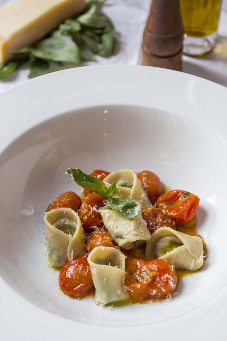 Spinach and Ricotta Tortellini with squashed roast tomatoes.