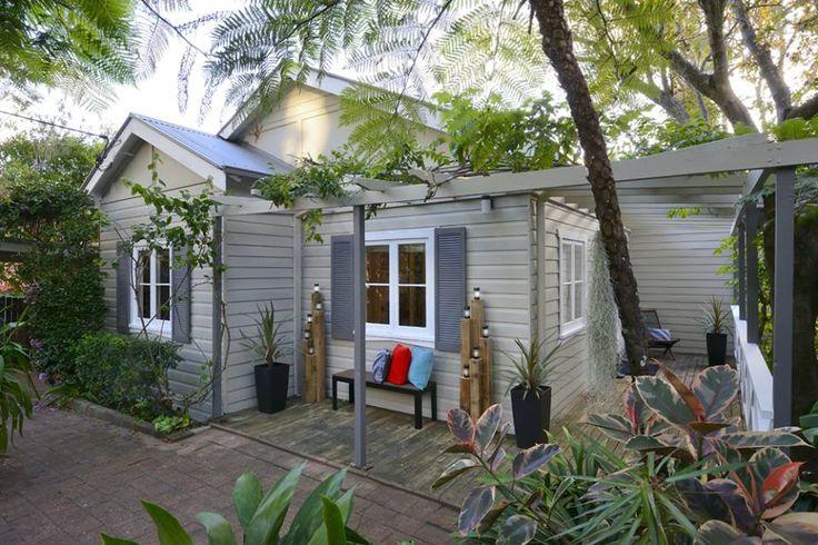 Colourbond Wallaby roof and trims; Colourbond evening haze cladding