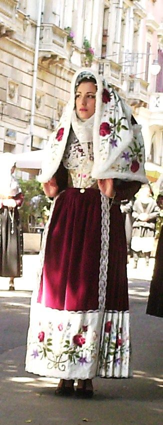 The traditional dresses and the colours of entire Sardinia in a moving and grand procession during the Festival of Sant' Efisio (Cagliari)