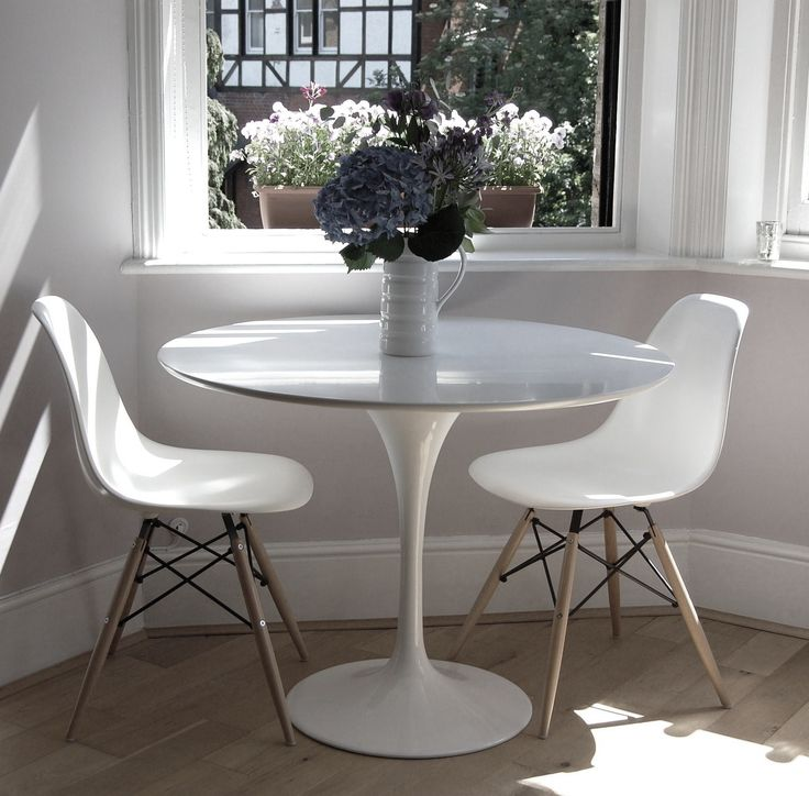 Tulip table with white Eames side chairs